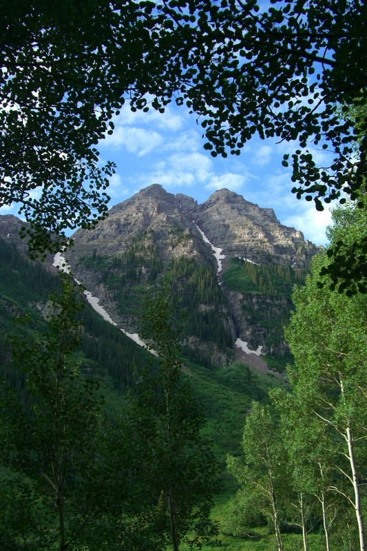 Approach to Pyramid Peak, framed by aspen trees.